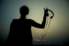 Silhouette girl  at sunset Stock Photo