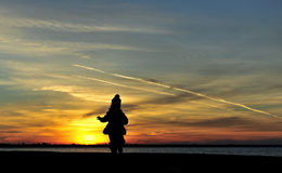 Silhouette girl sunset kid Stock Image