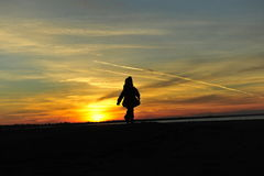 Silhouette girl sunset kid Stock Photo