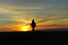 Silhouette girl sunset kid Stock Photo