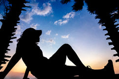 Silhouette of girl in a sunset Stock Photography