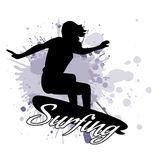 Silhouette of the girl of the surfer against the background of splashes in style grunge. On the image presented silhouette of the girl of the surfer against the Royalty Free Stock Photo