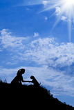 Silhouette of girl train a dog. Silhouette of siting girl train a dog Stock Photos