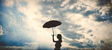 Silhouette of Girl with umbrella Stock Images