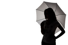 Silhouette of girl with umbrella Royalty Free Stock Photography
