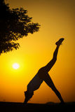 The silhouette of a girl who exercise fitness Stock Photo