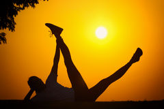 The silhouette of a girl who exercise fitness Royalty Free Stock Photo