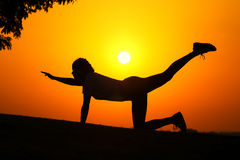 The silhouette of a girl who exercise fitness Stock Photography