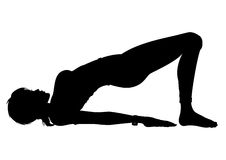 Silhouette Girl in the Yoga Bridge Pose (Setu Bandhasana) Stock Image