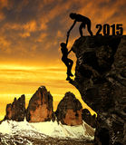 Silhouette girls climbs into the New Year 2015 Stock Photo