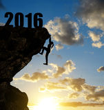 Silhouette girls climbs into the New Year 2016. Royalty Free Stock Image