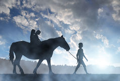 Silhouette of a girls with a horse Royalty Free Stock Image