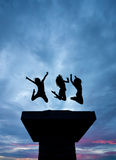 Silhouette of girls jumping on tower Royalty Free Stock Photo
