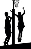 Silhouette of girls netball players jumping and blocking Stock Photos