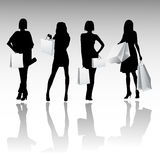 Silhouette girls shopping Stock Images