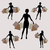 Silhouette of girls with shopping Stock Images