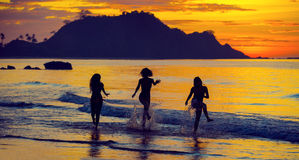 Silhouette of girls at sunset Royalty Free Stock Photo