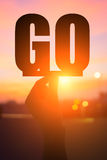 Silhouette go word. Silhouette of hand take go word with sunshine Royalty Free Stock Photo