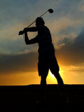 Silhouette of a golf player Royalty Free Stock Image