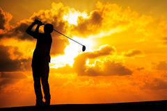 Silhouette golfer. Image of Silhouette golfer at sunset Stock Photos