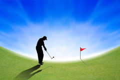 Silhouette of Golfer on green and blue sky Royalty Free Stock Image