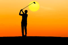 Silhouette golfer hitting golf Stock Photo