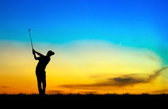 Silhouette golfer playing golf at beautiful sunset. Silhouette golfer playing golf during beautiful sunset Royalty Free Stock Image