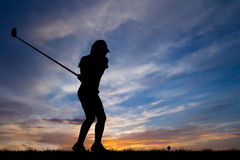 Silhouette golfer playing golf at beautiful sunset Royalty Free Stock Images