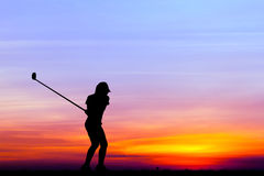 Silhouette golfer playing golf at beautiful sunset Stock Photo