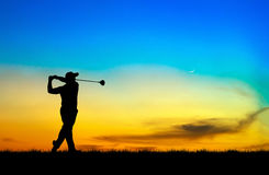 Silhouette golfer playing golf at beautiful sunset Stock Photography