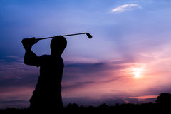 Silhouette golfer at sunset. Silhouette golfer at beautiful sunset Royalty Free Stock Photo