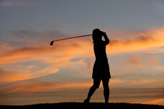 Silhouette of golfer swinging. Stock Photography