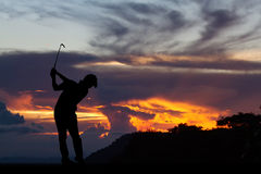 Silhouette of golfers hit sweeping and keep golf course in the s. Ummer for relax time Stock Photos
