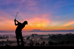 Silhouette of golfers hit sweeping and keep golf course in the s. Ummer for relax time Royalty Free Stock Image