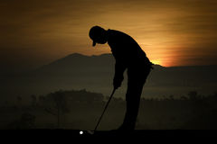 Silhouette of golfers hit sweeping and keep golf course in the s. Ummer for relax time Stock Photography