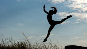 Silhouette of a graceful gymnast Stock Photography