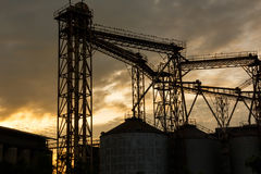 Silhouette of grain silo sunrise Stock Image