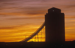 Silhouette of grain silo, sunset Royalty Free Stock Images