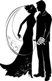 Silhouette of groom and bride Stock Photos