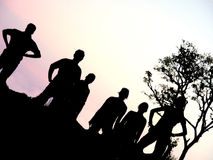 Silhouette Group. A group of six standing by and posing at sunset with there silhouettes Stock Photos