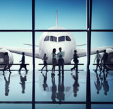 Silhouette Group of Business People with Airplane Concept Royalty Free Stock Image