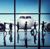 Silhouette Group of Business People with Airplane Concept Royalty Free Stock Images
