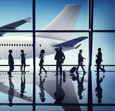 Silhouette Group of Business People with Airplane Concept Stock Photography