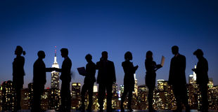Silhouette Group of Business People Interacting.  Royalty Free Stock Photo