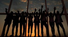 Silhouette of a group of business people raising their hand royalty free stock images