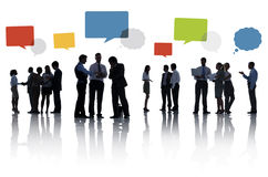 Silhouette Group of Business People with Speech Bubbles Stock Photography