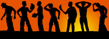 Silhouette of a group of cowboys in the sunset Stock Photography
