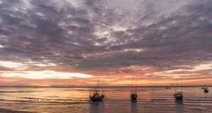Silhouette of group of fishing boat on sea Stock Photo