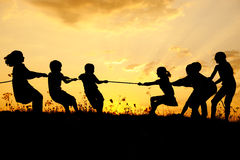 Silhouette, group of happy children royalty free stock photo