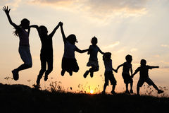 Silhouette, group of happy children stock image